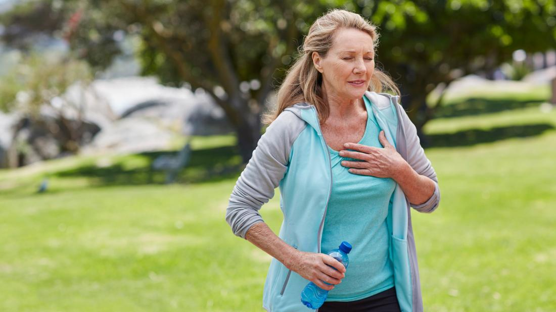 a female runner experiencing shortness of breath because of cardiomyopathy