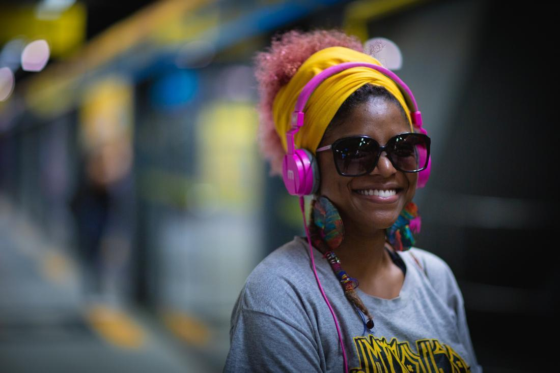 smiling person listening to music