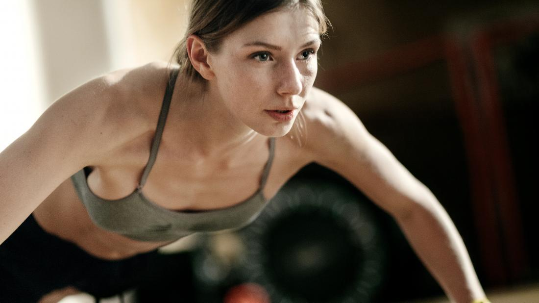 a woman doing pressups as part of her hiit workout and reaping all the benefits