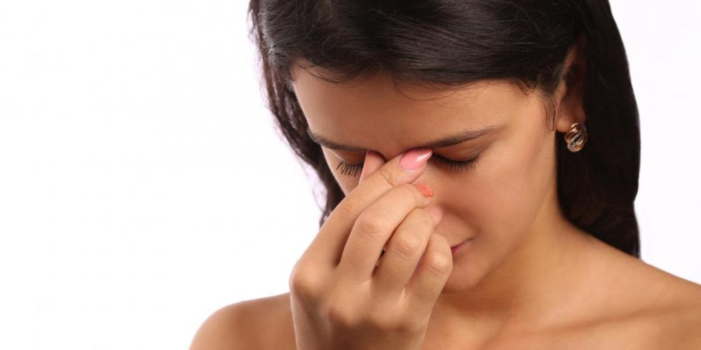 What is frontal sinusitis and what causes it?