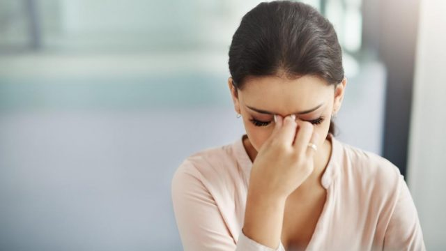 What causes blurred vision and a headache?