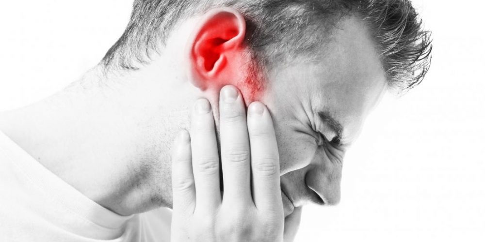 Why do I feel pain in my ear when swallowing?