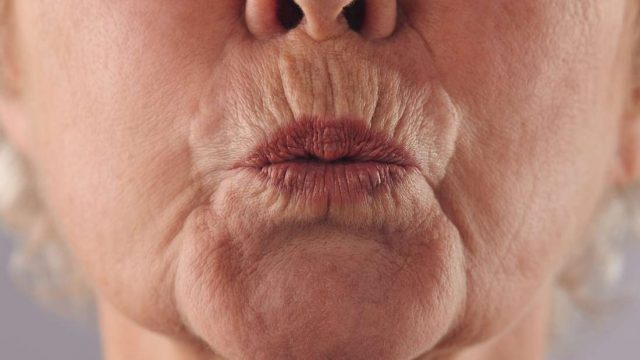 What is pursed lip breathing?