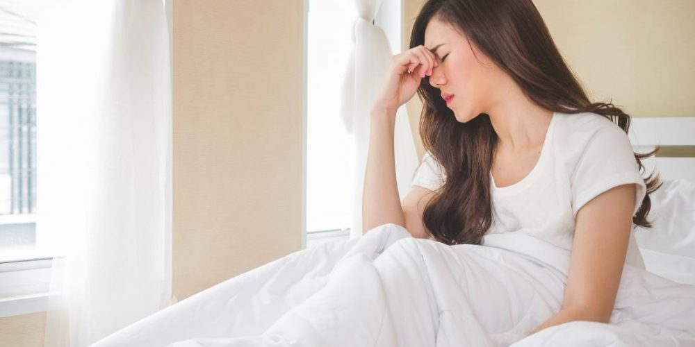 What can cause dizziness when waking up?