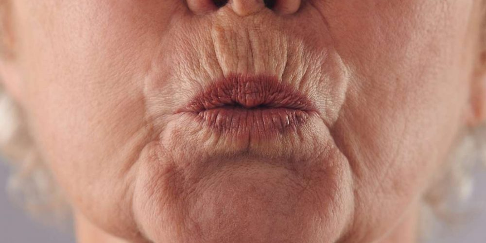 What is pursed lip breathing?