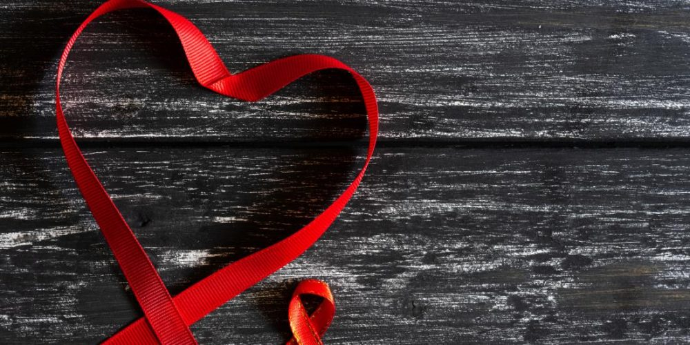 What chronic illnesses are people with HIV more likely to experience?