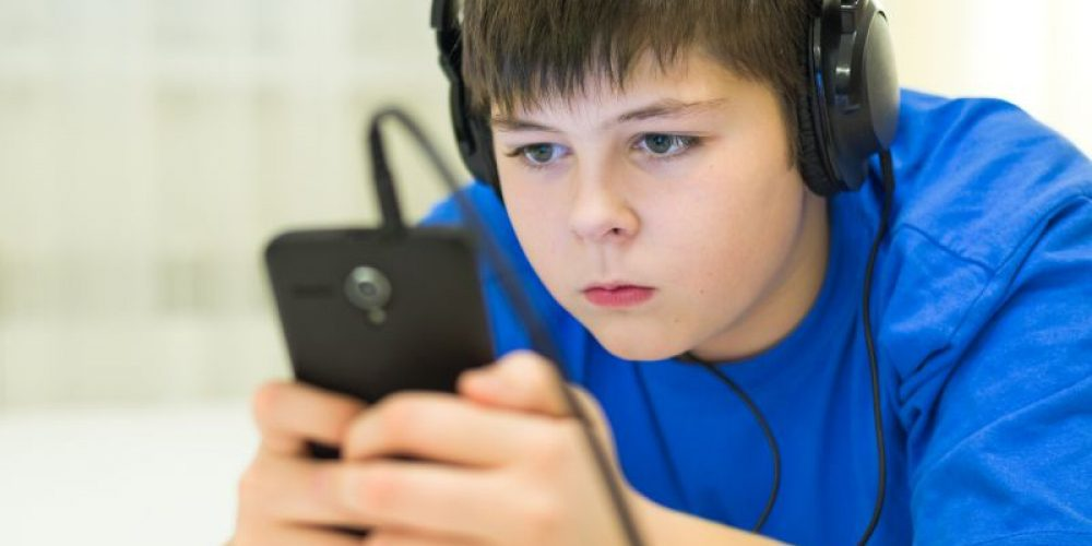 All That Screen Time Won't Hurt Your Kid's Grades – Maybe