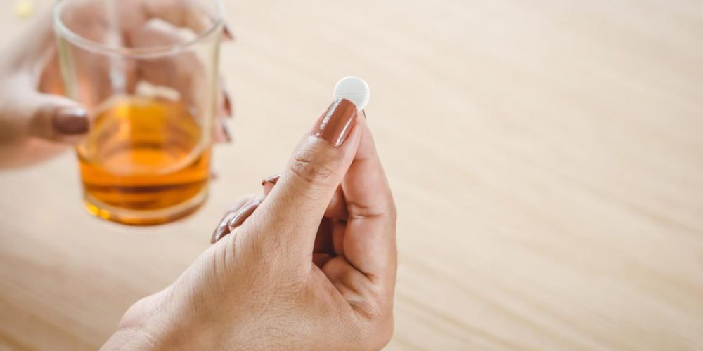 Is it safe to drink alcohol while taking prednisone?