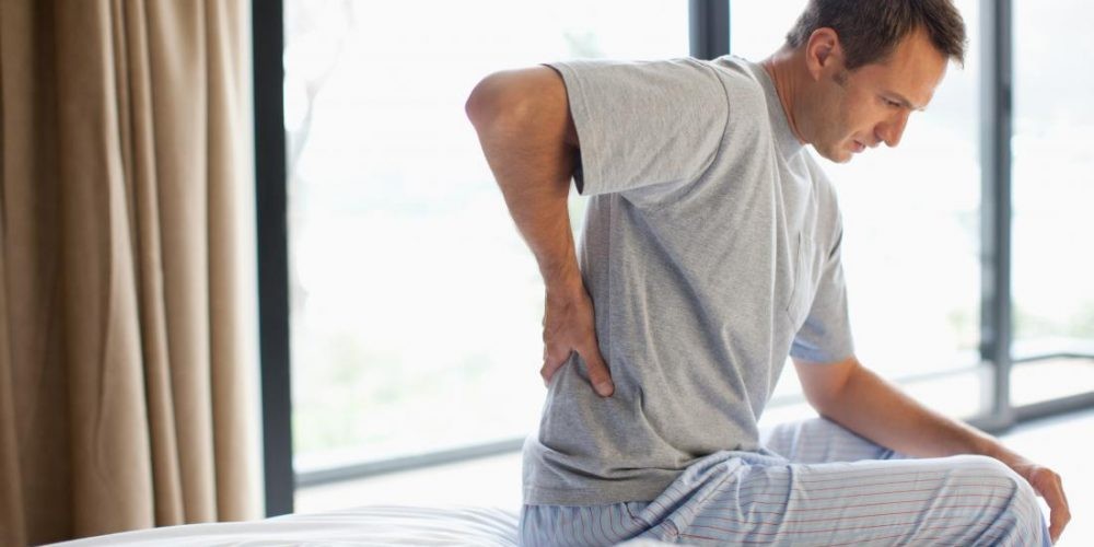 What are the most common causes of pelvic pain in men?