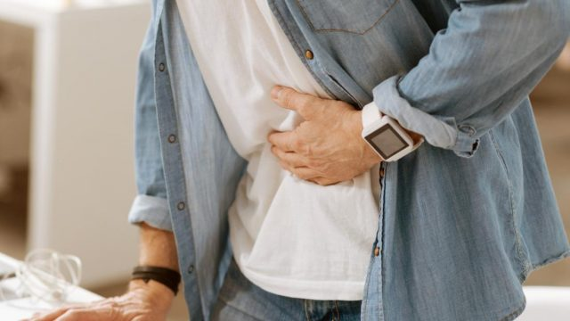 What can cause back pain and nausea?