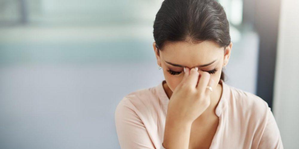 What causes blurred vision and a headache?