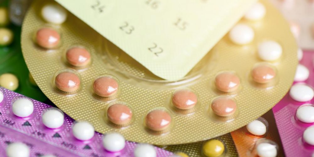 How do birth control pills affect menopause?