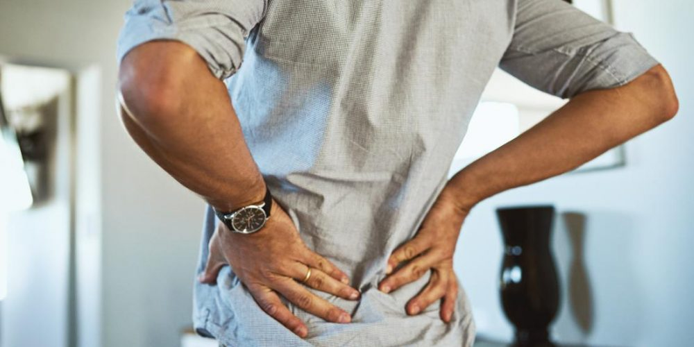 What can cause back pain while breathing?