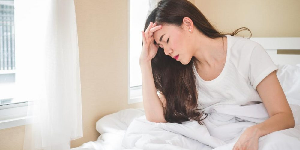 What causes dizziness when lying down?