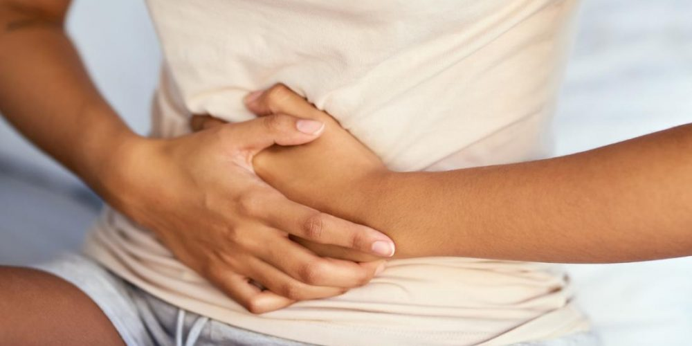 What causes upper stomach pain?