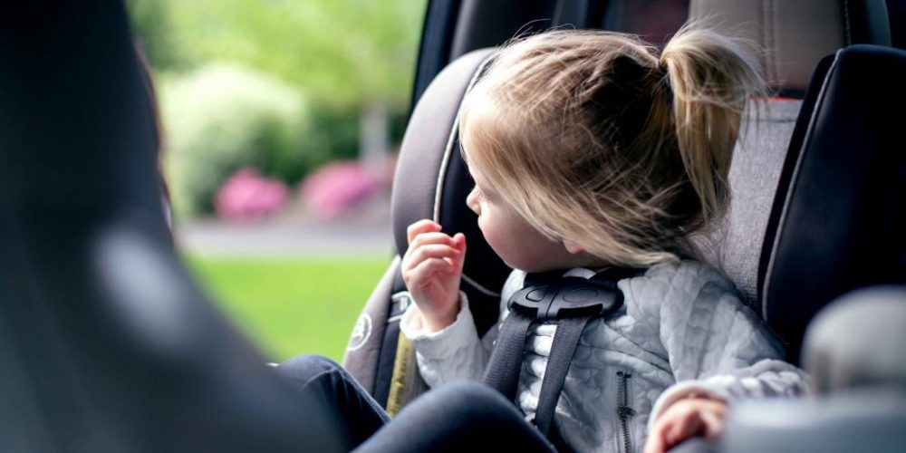 When can a child sit in the front seat of a car?