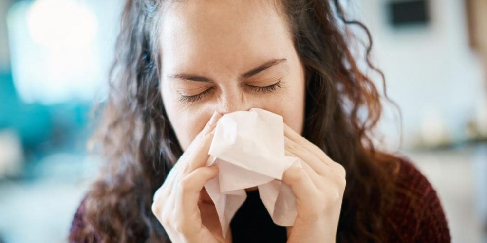 What can cause a headache and a nosebleed?