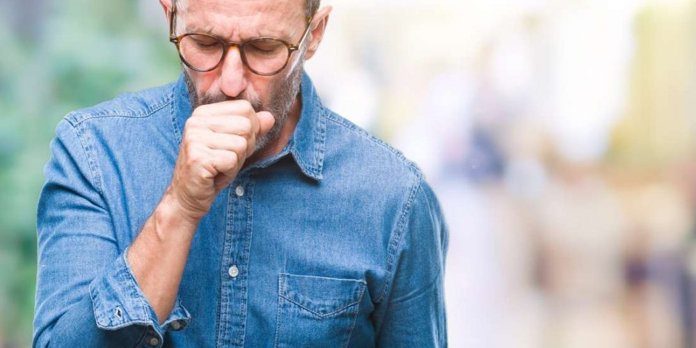What causes lower back pain when coughing?