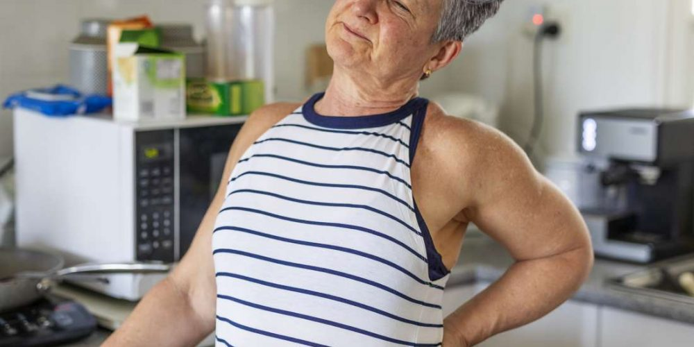 What can cause both lower back pain and diarrhea?