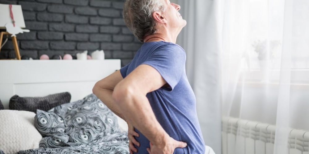 What can cause morning back pain?