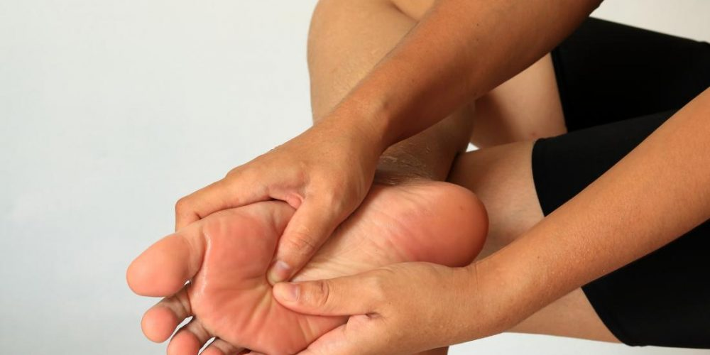 What causes a bump on the bottom of the foot?
