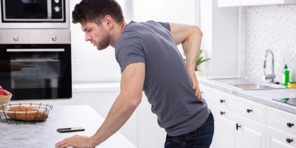 What causes bloody urine in men?